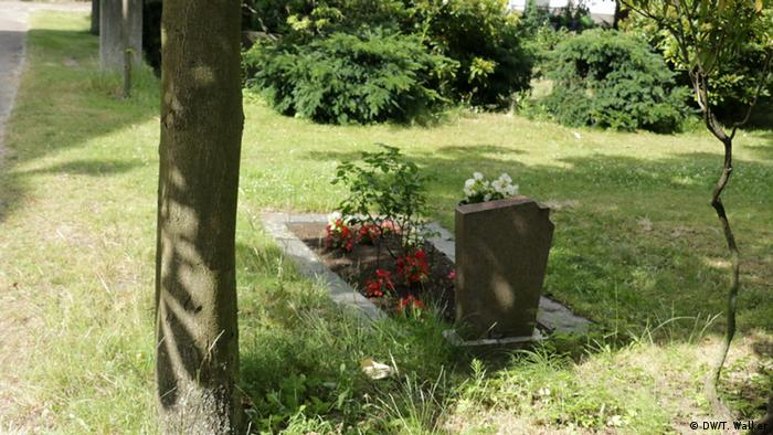 A grave next to a tree
