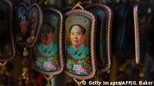 08.09.2016+++ Pendants with an image of late communist leader Mao Zedong hang in a stall in Beijing's Tiananmen Square on the eve of the 40th anniversary of his death, on September 8, 2016. September 9, 2016 marks the 40th anniversary of the death of Communist China's founding father Mao Zedong. +++ (C) Getty Images/AFP/G. Baker