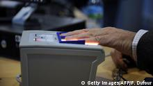 HOUSTON - FEBRUARY 1: An arriving passenger uses a new biometric scanner at George H. W. Bush Intercontinental Airport February 1, 2008 in Houston, Texas. The new system is set up to scan all ten fingers instead of the two finger scanners previously used. (Photo by Dave Einsel/Getty Images) Getty Images/AFP/F. Dufour