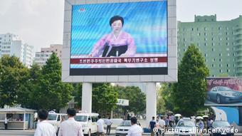 A big screen in front of Pyongyang Station shows the state-run Korean Central Television station reporting on North Korea's fifth nuclear test on Sept. 9, 2016. (Kyodo)   Copyright: picture-alliance/Kyodo