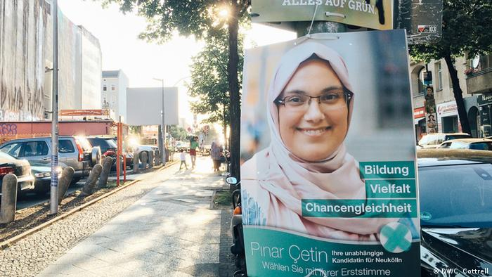 A campaign poster for a Turkish-German candidate hangs on a street in the Neukölln district of Berlin
