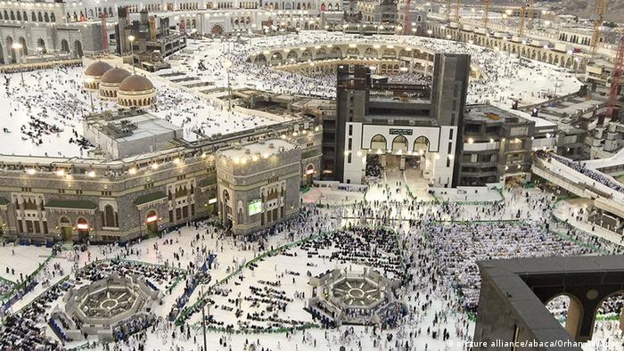 Muslim pilgrims are seen near the Kaaba, Islam's holiest site, located in the center of the Masjid al-Haram (Grand Mosque) in Mecca