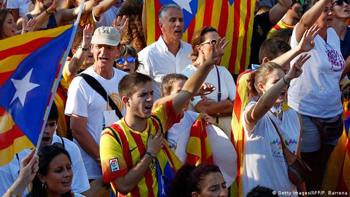 Demonstrators wave 'Estaladas' (pro-independence Catalan flags) and sing the Catalan national anthem