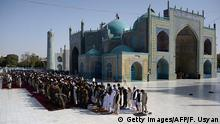 12.09.2016 ****Afghan Muslims offer Eid-al-Adha prayers at the Hazrat-i- Ali shrine in Mazar-i Sharif on September 12, 2016. Afghans started celebrating Eid al-Adha or 'Feast of the Sacrifice', which marks the end of the annual hajj or pilgrimage to Mecca and is celebrated in remembrance of Abraham's readiness to sacrifice his son to God. / AFP / FARSHAD USYAN (Photo credit should read FARSHAD USYAN/AFP/Getty Images) © Getty Images/AFP/F. Usyan