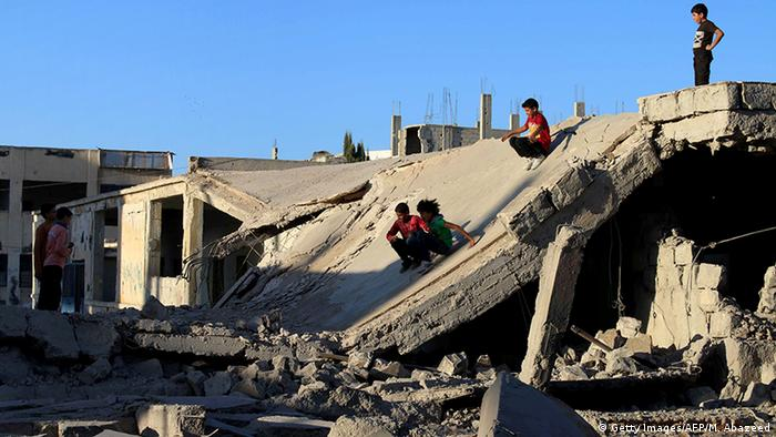 Kids playing in the ruins Copyright: Getty Images/AFP/M. Abazeed