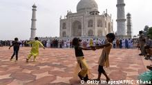 13.9.2016 *** TOPSHOT - Indian Muslim children play in the courtyard during the Eid al-Adha festival at the mosque inside the Taj Mahal in Agra on September 13, 2016. Muslims across the world celebrate the annual festival of Eid al-Adha, or the Festival of Sacrifice, which marks the end of the Hajj pilgrimage to Mecca and in commemoration of Prophet Abraham's readiness to sacrifice his son to show obedience to God. / AFP / CHANDAN KHANNA (Photo credit should read CHANDAN KHANNA/AFP/Getty Images) Copyright: Getty Images/AFP/C. Khana