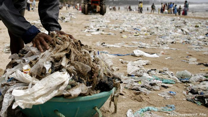 Man picking up plastic rubbish on Mumbai beach (Getty Images/AFP/P. Pillai)