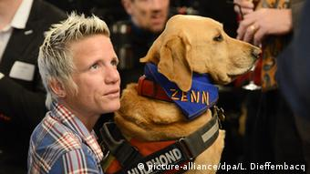 Marieke Vervoort and her dog Zenn picture-alliance/dpa/L. Dieffembacq