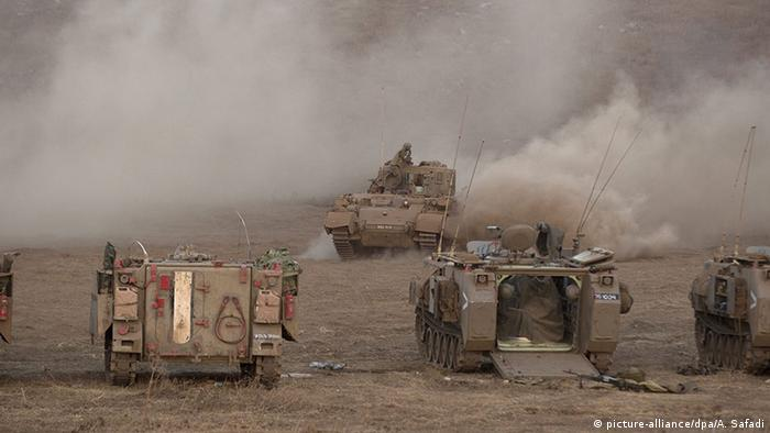 Israeli tanks carry out a military exercise on the Golan Heights