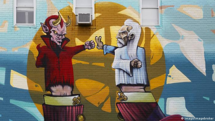 Symbolbild Teufel & Gott - Wandmalerei in Montréal, Kanada (Imago/imagebroker)