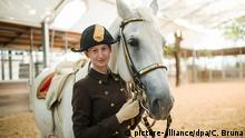 epa05538996 First female horse trainer at the Spanish Riding School, Hannah Zeitlhofer poses next to a Lipizzan horse after her inauguration at the Hofburg Palace hosting the Spanish Riding School in Vienna, Austria, 14 September 2016. After a 450 year tradition without female rider, 29-years-old Hannah Zeitlhofer became the first female horse trainer and rider at the Spanish Riding School, which is part of the UNESCO world heritage list of intangible cultural heritage of humanity. EPA/CHRISTIAN BRUNA   picture-alliance/dpa/C. Bruna