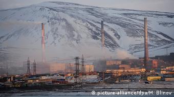 Cidades construídas sobre o permafrost, como Norilsk, na Rússia, poderão desmoronar devido ao aquecimento global.