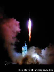 In this TV grab, a Long March 2F (CZ-2F) carrier rocket carrying China's second orbiting space lab Tiangong-2 blasts off at the Jiuquan Satellite Launch Center near Jiuquan, northwest China's Gansu province, 15 September 2016.