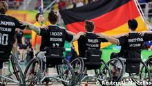 Rio_Paralympics_Momente_16_09 +++ 2016 Rio Paralympics - Wheelchair Basketball - Final - Women's Gold Medal Final - Germany v USA - Rio Olympic Arena - Rio de Janeiro, Brazil - 16/09/2016. Players of Germany at the front of their national flag listens to national anthem before the match. +++ (C) Reuters/U. Marcelino