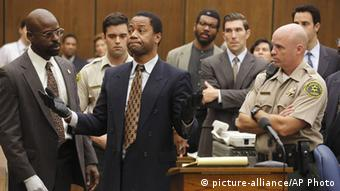Cuba Gooding puts on the gloves, high-lighting a pivotal scene from the OJ Simpson murder trial.