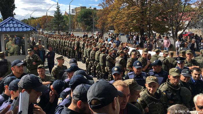 Protesters outside of the Russian embassy in Kiev are blocked by Ukrainian troops.