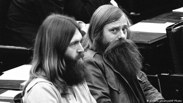 Two long-haired and long-bearded Green MPs sitting in the Bundestag plenary in 1983