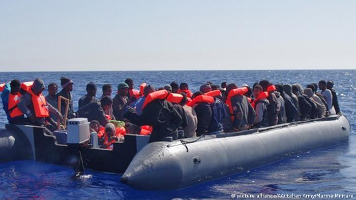 Migrants crossing the Mediterranean in a boat
