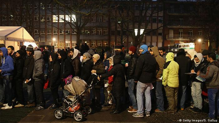 People waiting outside Berlin's refugee office (Getty Images/S. Gallup)