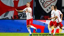 21. September 2016 Leipzig's forward Timo Werner (L) celebrates scoring the opening goal during the German first division Bundesliga football match between RB Leipzig and Borussia Moenchengladbach in Leipzig, eastern Germany, on September 21, 2016. / AFP / Odd ANDERSEN / RESTRICTIONS: DURING MATCH TIME: DFL RULES TO LIMIT THE ONLINE USAGE TO 15 PICTURES PER MATCH AND FORBID IMAGE SEQUENCES TO SIMULATE VIDEO. == RESTRICTED TO EDITORIAL USE == FOR FURTHER QUERIES PLEASE CONTACT DFL DIRECTLY AT + 49 69 650050 (Photo credit should read ODD ANDERSEN/AFP/Getty Images) (c) Getty Images/AFP/O. Andersen