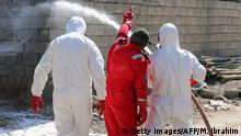 Members of the civil defence spray and clean areas in the town of Taza, around 220 kilometres north of the capital Baghdad, on March 13, 2016, that might have been contaminated in a chemical attack carried out by the Islamic State (IS) group the previous week. Local officials have said that IS used mustard agent in the attack but the samples are still being analysed and definitive results from the Organisation for the Prohibition of Chemical Weapons based in The Hague sometimes take months. +++ (C) Getty Images/AFP/M. Ibrahim