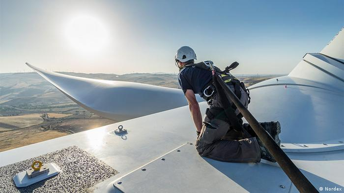 Wind energy worker atop a wind turbine (Nordex)
