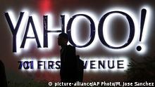 Oct. 26, 2015 FILE - In this Nov. 5, 2014, file photo, a person walks in front of a Yahoo sign at the company's headquarters in Sunnyvale, Calif. Yahoo announced Wednesday, March 2, 2016, that the company is adding a new component to its Sports vertical: competitive video gaming. Yahoo said that Esports will offer video coverage of live tournaments, including expert commentary and interviews with top players. Esports will also include articles, scores, team rosters, schedules, player rankings, calendars and statistics. (AP Photo/Marcio Jose Sanchez, File) | (c) picture-alliance/AP Photo/M. Jose Sanchez