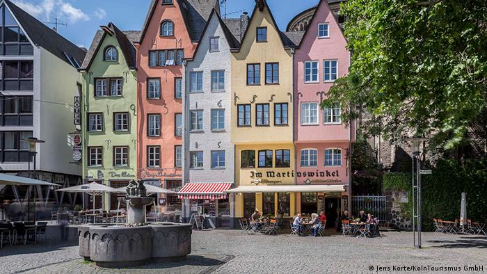 House facades at Cologne's Fischmarkt in the old town center, Germany (Jens Korte/KölnTourismus GmbH)
