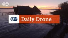 DW Daily Drone Pfahlbauten DDLogo