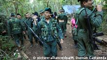 21.9.2016 *** epa05551060 Guerrillas leave after receiving instructions by their commanders outside the place where the 10th FARC (Revolutionary Armed Forces of Colombia) National Conference takes place, in El Diamante, Caqueta's Department, Colombia, 21 September 2016. EPA/MAURICIO DUENAS CASTANEDA Copyright: picture-alliance/dpa/M. Duenas Castaneda