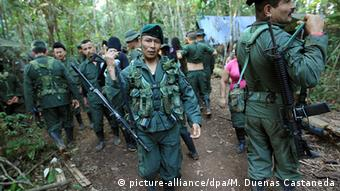 Guerrillas leave after receiving instructions by their commanders