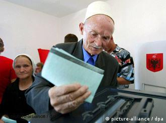An elderly Albanian couple vote in the village of Bathore, Albania, on Sunday 03 July 2005. Albanians will select a new legislature after a close and exceedingly hard-fought election campaign.The 2.9 million voters will cast ballots for 140 legislators, choosing from 57 parties and coalitions in the sixth election since the fall of Communism in the country in 1991
