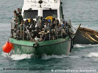 The Spanish coast guard transporting rescued African refugees to the Canary Islands