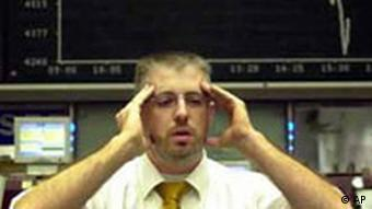 A stock trader reacts in front of the indicator panel