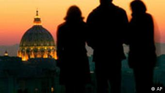 Silhouettes of three people with the illuminated dome of St. Peter's Basilica in the background