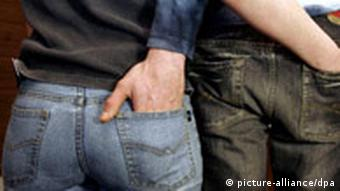 Couple with hands in each others' back pockets