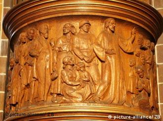 Jesus, a German soldier and an Aryan family adorn the pulpit