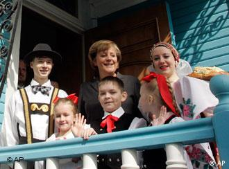 German Chancellor Merkel with ethnic Germans in the Siberian city of Tomsk last year