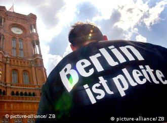 Berlin is bankrupt, reads the man's T-shirt outside the German capital's city hall