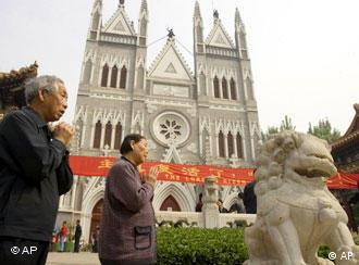 Chinese faithfuls pray outside the Xishiku Catholic Church in Beijing, China, Sunday, May 7, 2006. China on Sunday rejected Vatican criticism of its ordination of two Roman Catholic bishops without papal approval as the official Chinese church prepared to name yet another bishop. (AP Photo/Ng Han Guan)