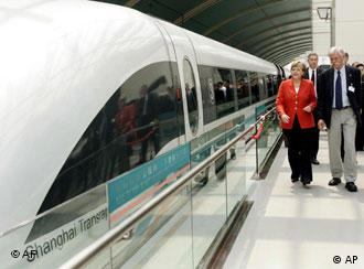 Angela Merkel about to board the Shanghai Transrapid on May 23, 2006