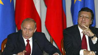 Russian President Vladimir Putin, left, speaks during a press conference next to European Commission President Jose Manuel Barroso