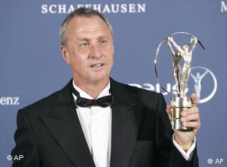 Dutch soccer legend Johan Cruyff holds his lifetime acheivement award during the Laureus World Sports Awards in Barcelona, Spain, Monday May 22, 2006.
