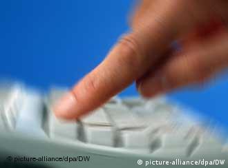 Finger typing onto keyboard