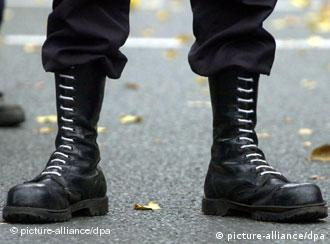 Laced black boots often worn by extremists