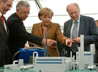 German Chancellor Merkel takes a look at a model of the world's first Co2-free coal plant