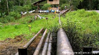 General view of oil pipelines that have been placed near a house at Yasuni National Park, in the Ecuadorean Amazonia, on Thursday 05 August 2004. Environment activists from Ecuador, Colombia, Brazil, Spain, Belgium, Peru and Canada held today a press conference in Quito to ask the Ecuadorean government to deny the environment permit that Brazilian Petrobras oil company has requested to work at Yasuni National Park. The activists said that the indigenous inhabitants have denounced environment damages as a consequence of oil companies operations, such as Spaniard-Argentinian Repsol and Canadian Encana. Foto: Nathalie Weemaels dpa