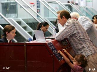 A passenger at check-in at a London airport
