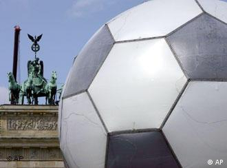 A giant soccer ball with the Brandenburg Gate in the background.