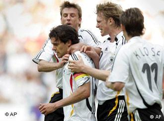 Ballack received his team's congratulations for a goal against Colombia -- then a calf injury